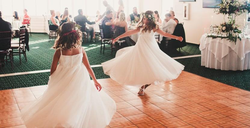 Two flower girls twirling on the dance floor at a wedding reception in Dunedin, FL